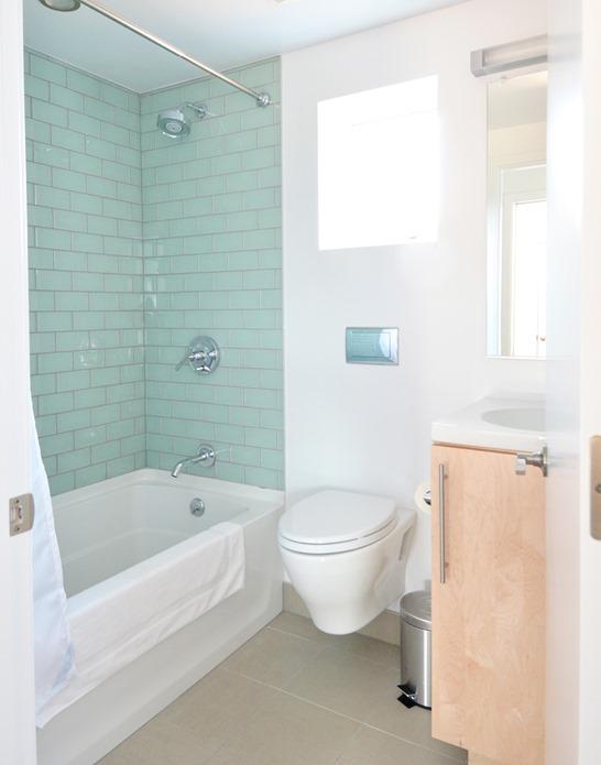 blue glass tile shower maple vanity