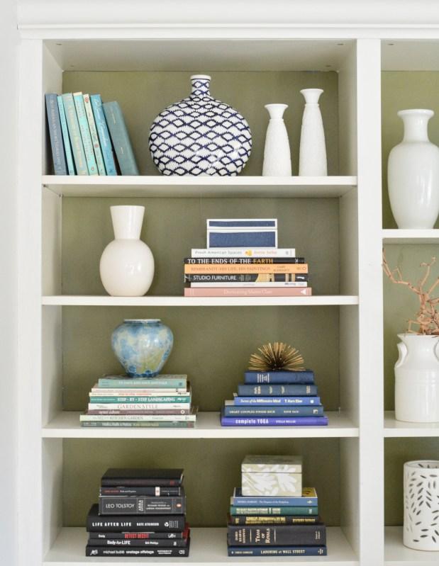 olive green backed bookshelves