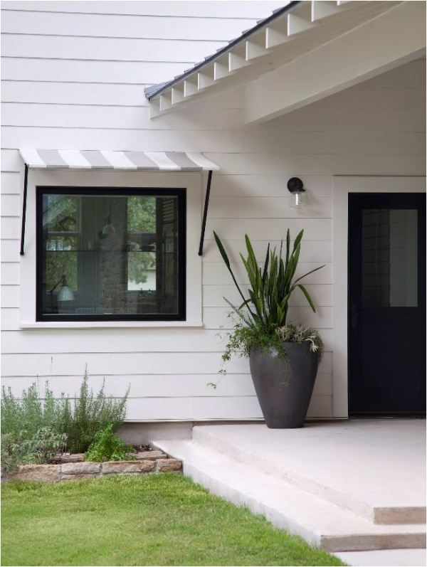black window with awning