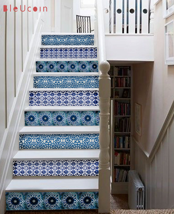 blue and white tile decals on staircase