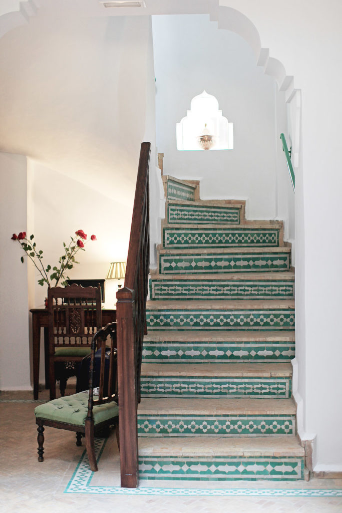 green moroccan tiled staircase