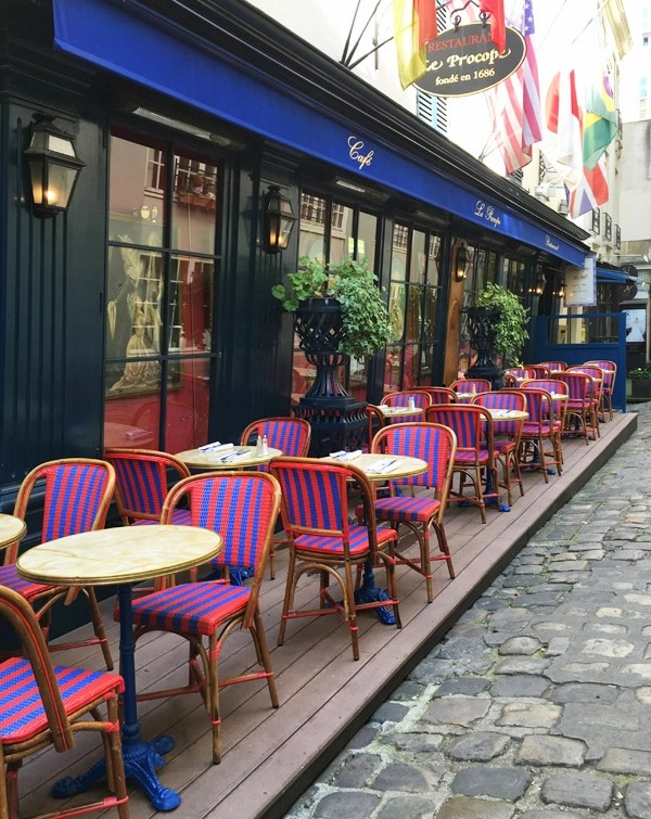 striped chairs parisian cafe