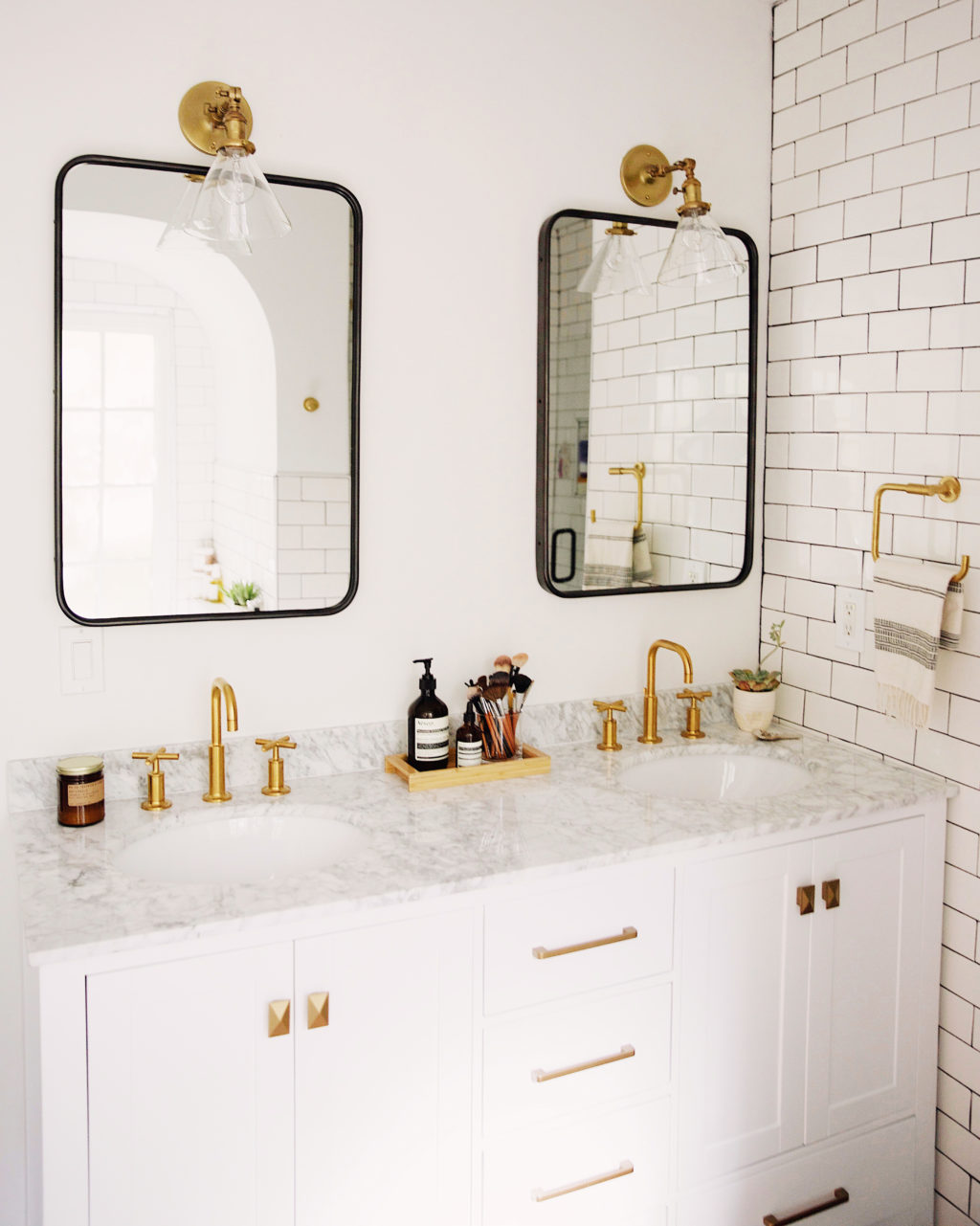 One Bathroom Has Brass Faucets, The Other Has Black Ones That Play Off The  Black Mirror. Both Look Amazing.
