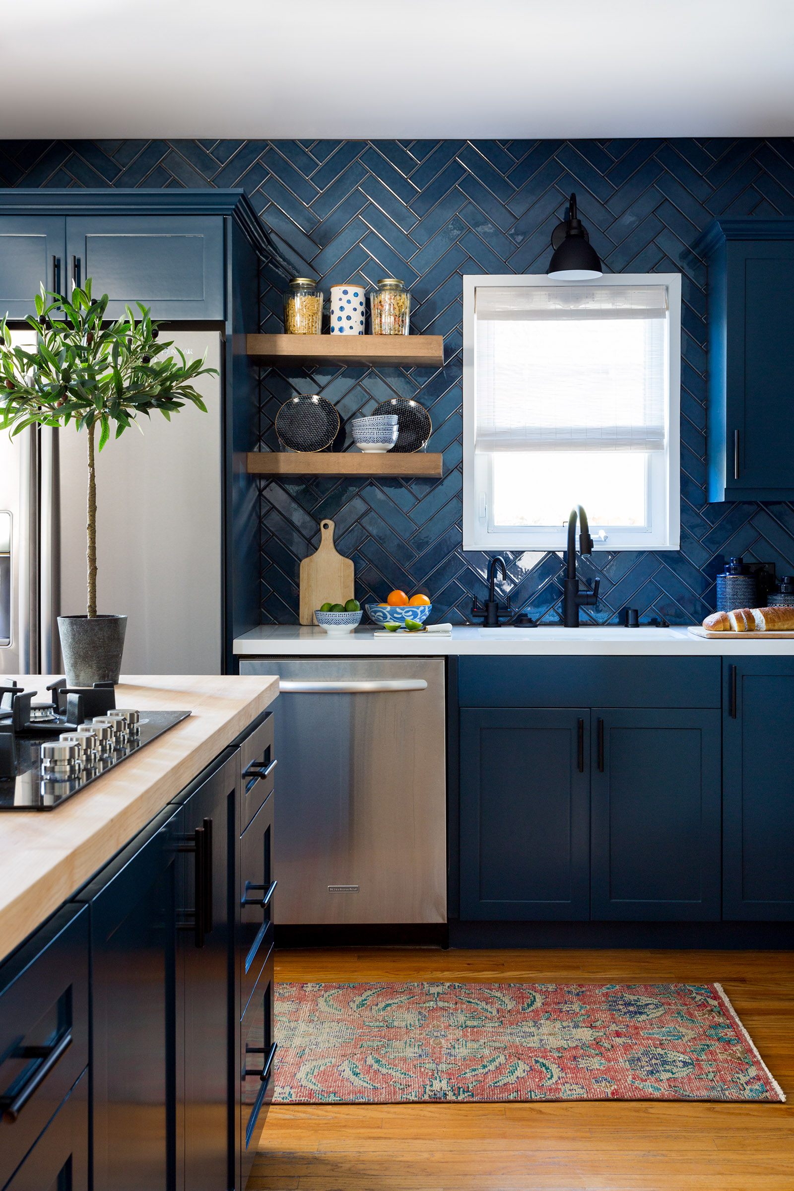 I\u0027m crazy about this deep moody blue cabinets and the coordinating herringbone tile backsplash isn\u0027t it stunning? Kitchen design by Jenn Feldman ... & Forever Classic: Blue Kitchen Cabinets - Keriel Craft - Blog