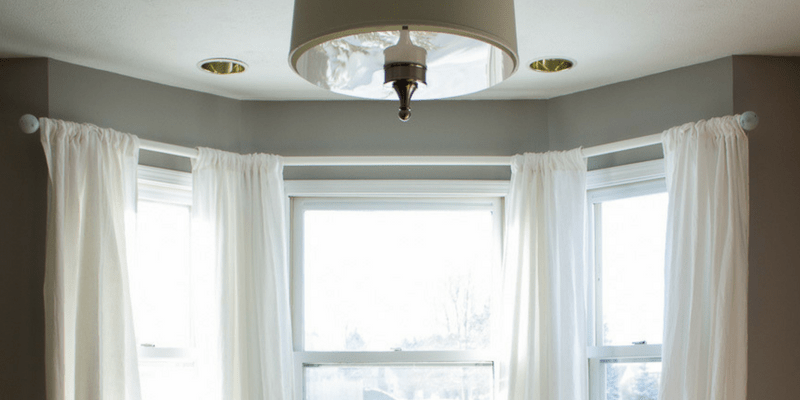 How to Make a Simple, Gorgeous Bay Window Curtain Rod from Cheap Dowels