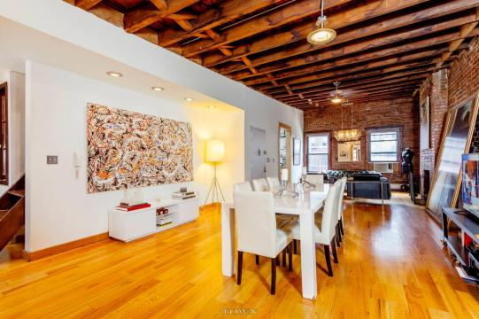 A 32 Foot Long Living Room With Exposed Brick Dominates This throughout ucwords]