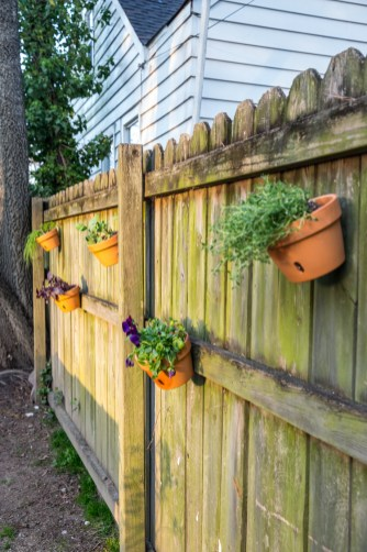 How To Make A Fence Herb Garden With Terra Cotta Pots in ucwords]