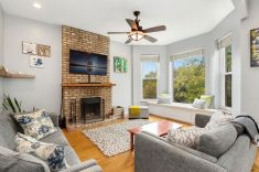In A Lakeview Greystone A Cozy Condo With A Fireplace Asks pertaining to 10+ Adorable Fireplace Living Room