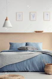Lamp Above Blue Bed With Pillows In Boho Bedroom Interior With pertaining to 13+ Bohemian Bedrooms That'Ll Make You Want To Redecorate Asap