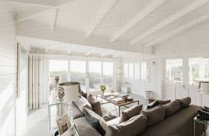 Sunny Luxury Home Showcase Living Room With White Wood Beam Vaulted Ceiling Stock Photo throughout ucwords]