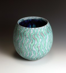 Grey green open vessel with deep blue interior 18 cm h 18 cm diam