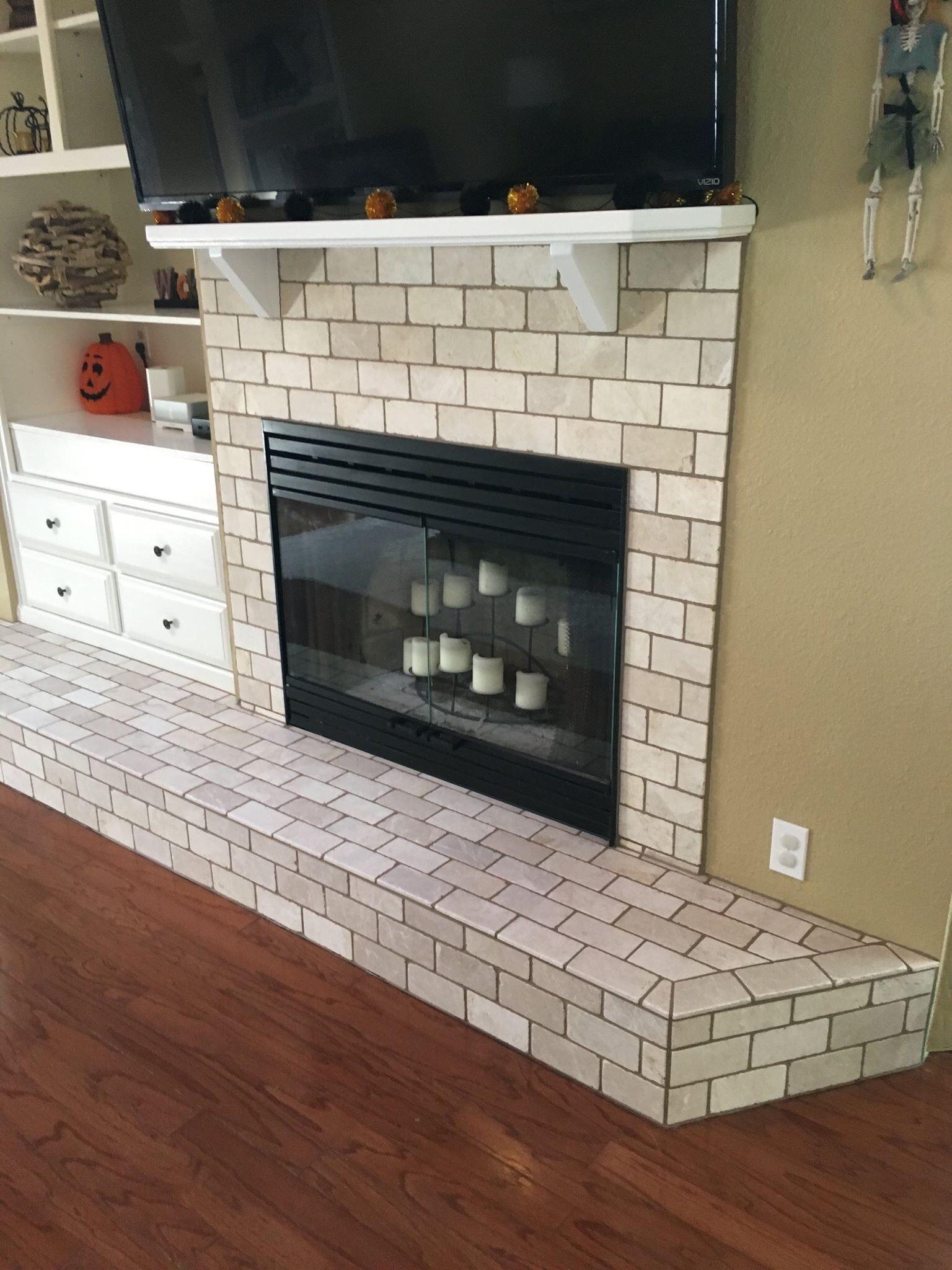 6 tumbled marble subway tile fireplace