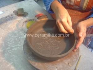 argila decorada com escavados
