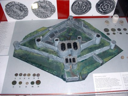 Aberystwyth Castle and a selection of coins produced at the Royal Mint
