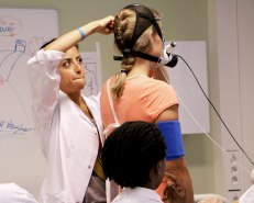 Engineer Atefe Tari preparing woman for vo2 max test on treadmill
