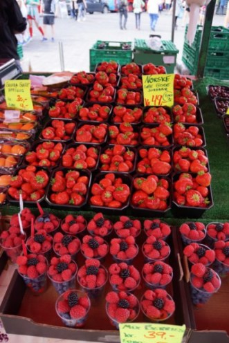 Lots of strawberries and rasberries ready for being sold