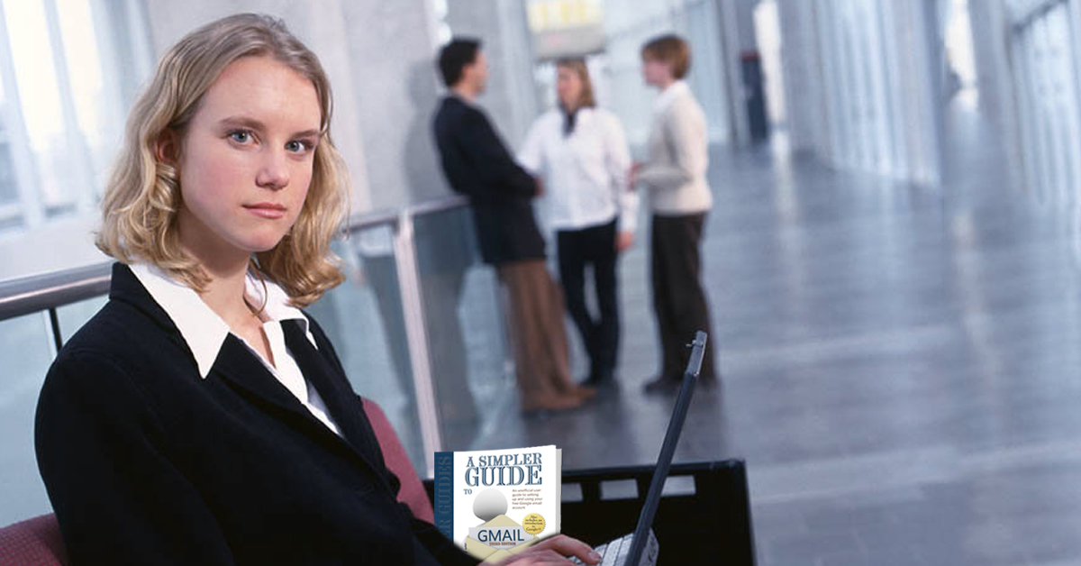 Business woman in corridor with a Copy of A Simpler Gyuide to Gmail