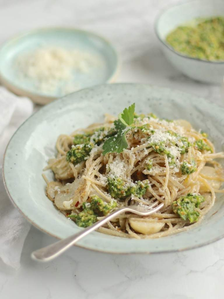 A simple vegetarian pasta dish with sautéed Jerusalem Artichokes, Spaghetti, hazelnut parsley pesto, and lots of grated Parmesan | Natural Kitchen Adventures