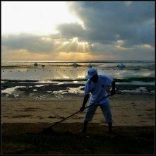 A beach guy, ebb tide and sunrise - Bali
