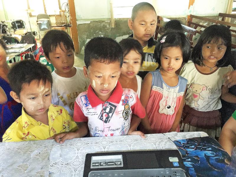YL Church Computer viewing_Cetana Educational Foundation