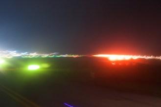 Beim Start aus dem Flugzeugfenster fotografiert
