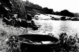Coracle sind kleine runde Boote aus Korbgeflecht, die über den Fluss zwischen Hampi und Anegundi paddeln