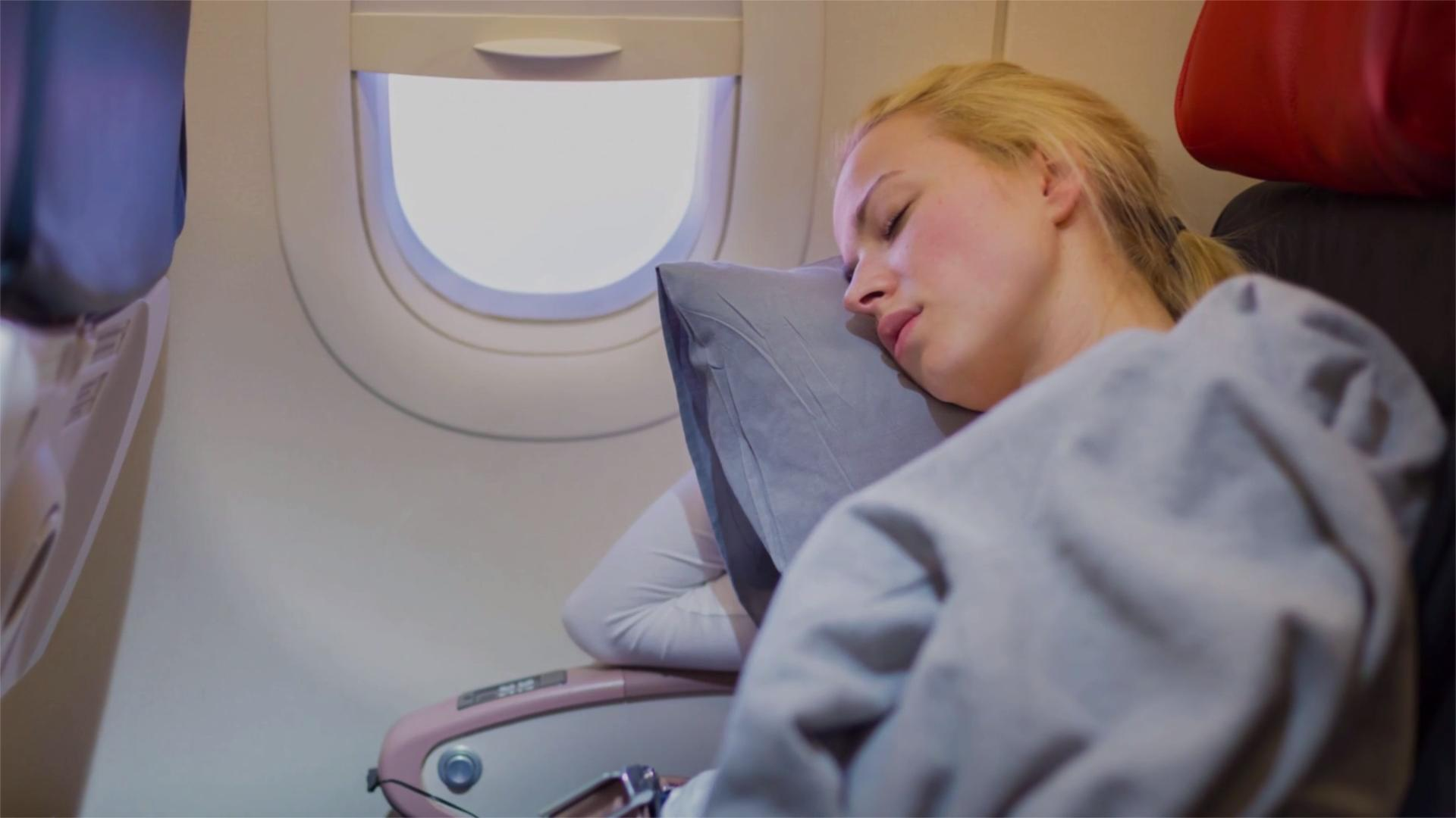 how to actually get restful sleep on a plane