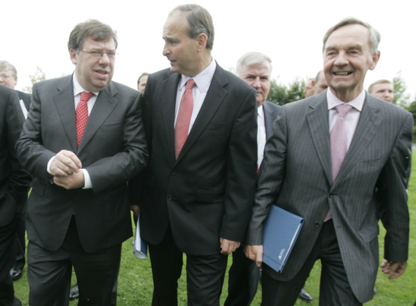 15/9/2009. FF Day 2. L to R. Taoiseach and Leader of Fianna Fail, Brian Cowen and Minister for Foreign Affairs Micheal Martin are joined by Dr Michael Woods TD after the family photo, on the second day of the Summer 09 FF Think-In at the Hodson Bay Hotel outside Athlone. Photo: Eamonn Farrell/Photocall Ireland