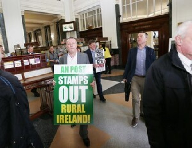 14/3/2017 Postmaster Protest. Pictured are postmasters protesting inside the GPO as members of the public go about their business. The postmasters say that they will resist any Post Office closures driven by An Post. They are also demanding publication and implementation of a Government commissioned report on the future of the Post Office Network which was finalised last year. Photograph: RollingNews.ie