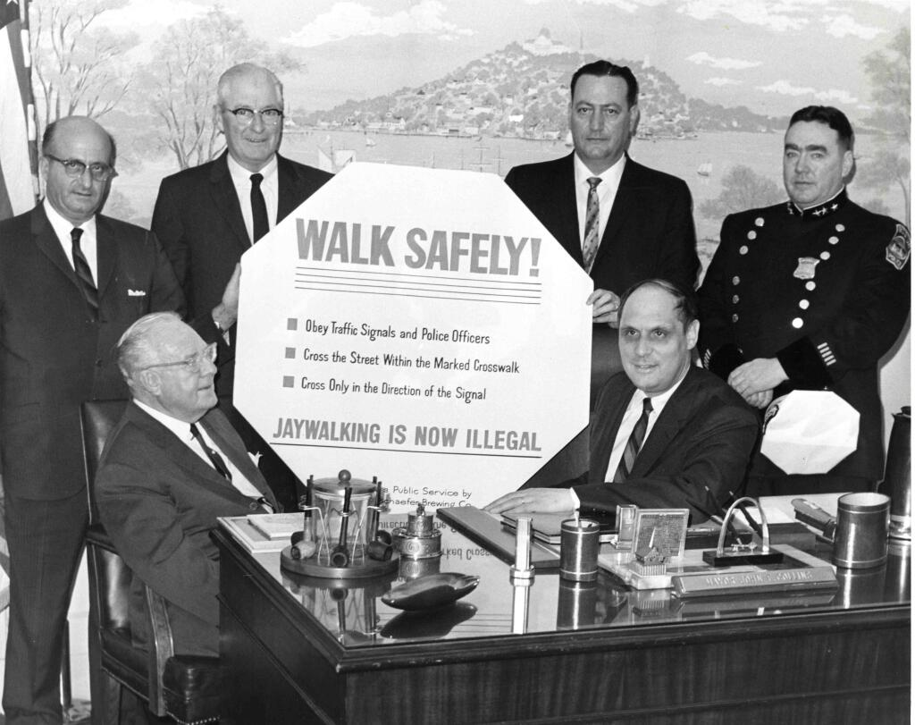 In 1962, Boston formally adopted jaywalking laws to penalize pedestrians, as this photo of city officials shows.