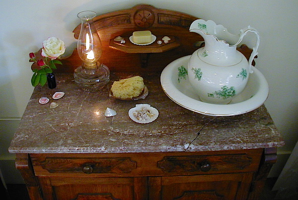 For daily bathing, Sarah uses an antique ceramic bowl-and-pitcher set in her bedroom. (From ThisVictorianLife.com)
