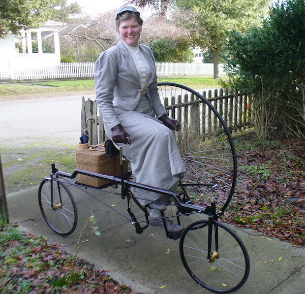 Sarah demonstrates how a Victorian woman would have ridden her tricycle. (From ThisVictorianLife.com)