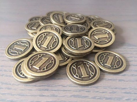 36 metal coins (22x3mm) are included in every copy of Charterstone