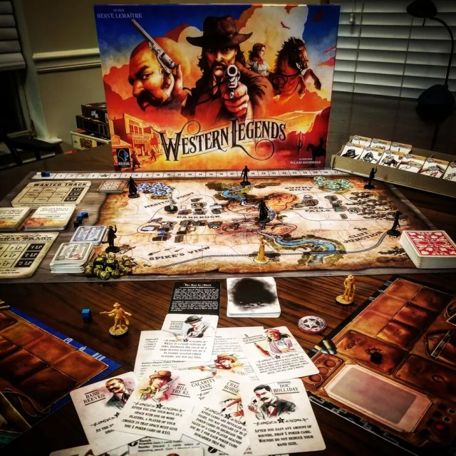Picture of Western Legends box and componenets set up for play.
