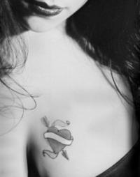 In Between Breast Heart Tattoo