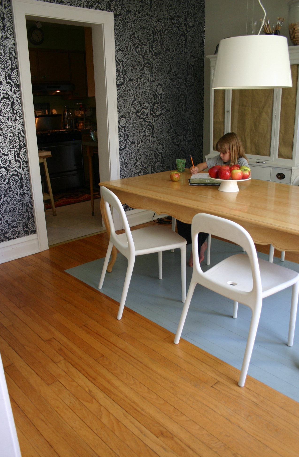 With children in the house a painted dining room floor is the perfect alternative to a rug