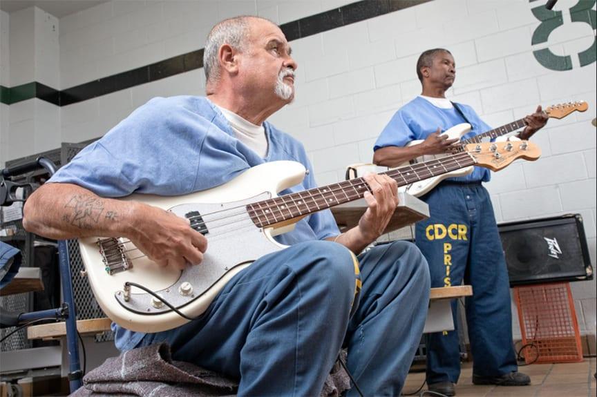 Men playing guitars