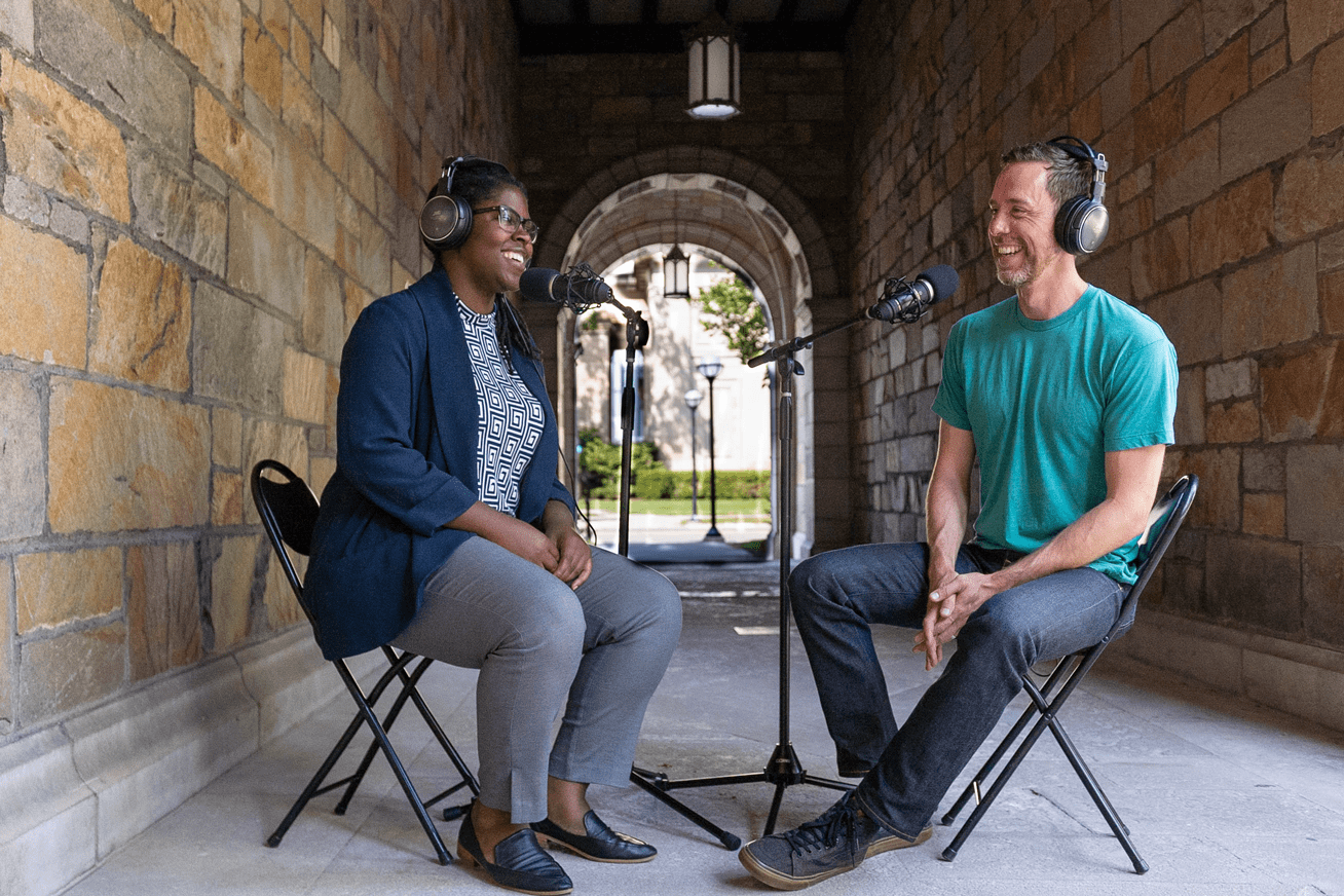 Brian Hayden interviewing fellow CFE instructor outside for podcast