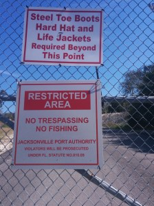 A warning sign that speaks for itself, bordering Jacksonville Port Authority land in Arlington. How could a person wear all that stuff?