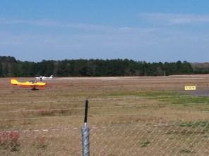 Two planes cross on parallel runways at Craig Field in East Arlington.