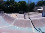 The wild, sloping concrete course at Kona Skatepark, with the main building in the background.