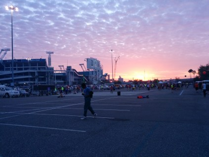 A lovely sunrise behind EverBank Field as thousands of runners gather for the start of the Gate River Run.