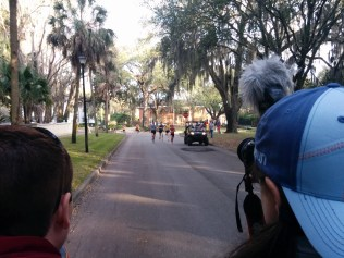 This scene from River Road in San Marco is the essence of the Gate River Run. Three men (in blue, purple, and yellow) are pulling away from the men's pack and overtaking some of the women who started earlier in the morning.