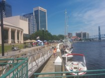 A view of creators' tents at OneSpark, viewed from just behind the Times-Union Center for the Performing Arts. The Jacksonville Landing and Main Street Bridge are in the distance.