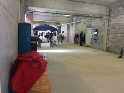 It's a view of the inner hallways of Hodges Stadium. Spectators entering the venue pass through this area.