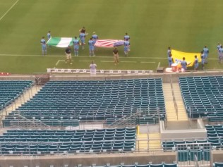 Young soccer players from Jacksonville FC rehearse the pregame flag ceremonies before the USA-Nigeria international match.