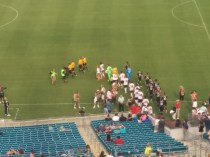 Fulham and D.C. United players enter the field for soccer action at EverBank Field.
