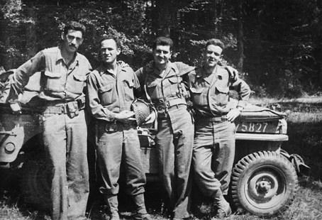 J.D. Salinger, left, after the Normandy invasion