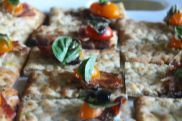 Herbed Flatbread topped with apple wood smoked bacon, heirloom tomato, creme fraiche, and basil