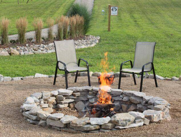 Amazing fire pit ideas on a slope to make s'mores with your family